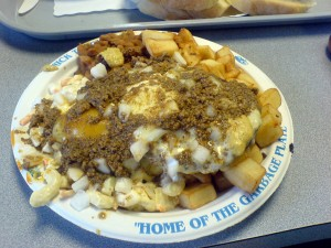 The Nick Tahou Garbage Plate with baked beans and a fried egg